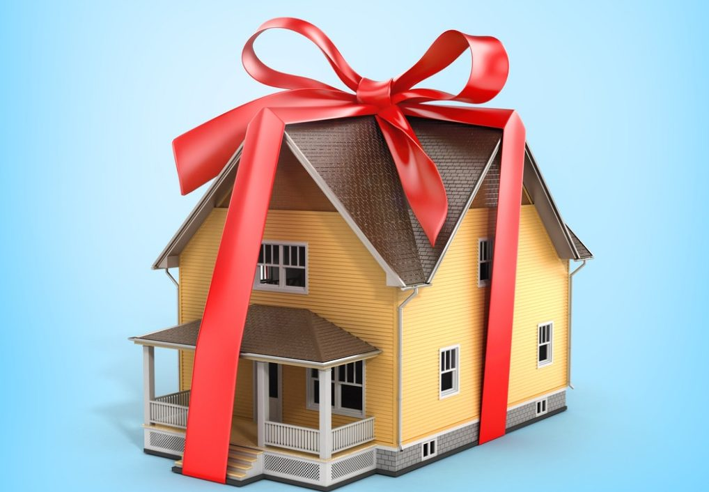 House wrapped with red bow
